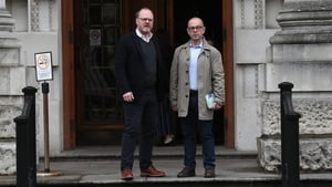 Trevor Birney (L) and Barry McCaffrey outside the court in Belfast