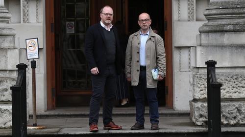 Trevor Birney (L) and Barry McCaffrey outside the court in Belfast