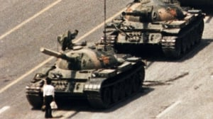 A lone demonstrator halts a column of tanks at Tiananmen Square, the day after Chinese troops fired on pro-democracy students