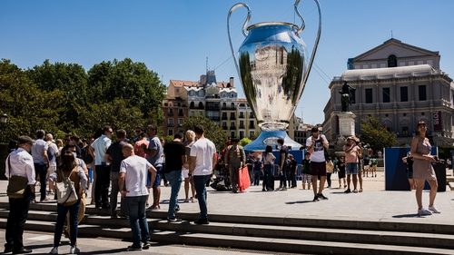 A huge UEFA Champions League Cup seen in front of Palacio Real de Madrid