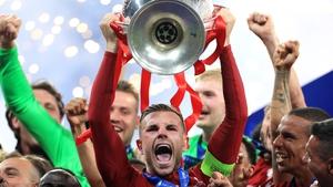 Jordan Henderson lifting the Champions League trophy in 2019