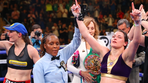 Katie Taylor celebrates winning the majority points decision
