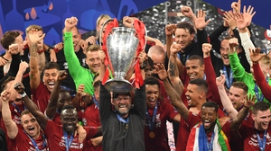 Liverpool manager Jurgen Klopp and his players celebrating with the Champions League trophy last June