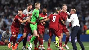 Liverpool goalkeeper Caoimhin Kelleher celebrates with his team-mates
