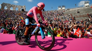 Overall race winner Team Movistar rider Ecuador's Richard Carapaz