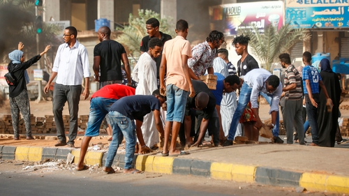 Gunfire, blasts in Sudan's capital as protest site raided