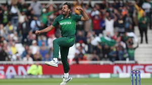 Pakistan bowler Wahab Riaz celebrates after taking the wicket of Chris Woakes