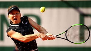 Simona Halep charged into the quarter-finals at Roland Garros
