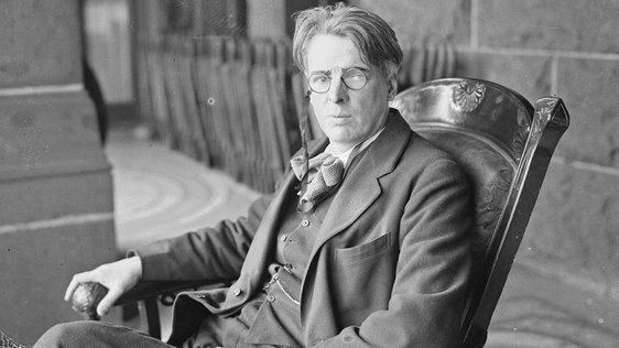 William Butler Yeats, well-known Irish poet, sitting in a rocking chair on the porch of a building, Chicago, Illinois, March 1920. Photo by Chicago Sun-Times/Chicago Daily News collection/Chicago History Museum/Getty Images