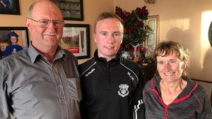 MJ Malone, pictured with his parents, said he would get up a little earlier due to the traffic restrictions