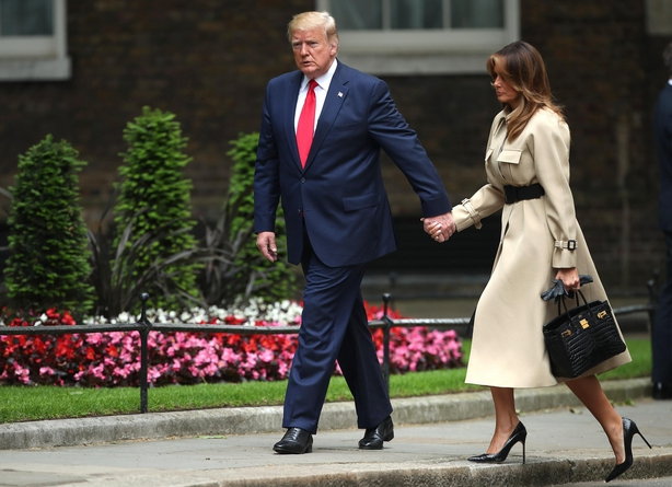 US President Donald Trump and first lady Melania Trump arrive in Downing Street, London, on the second day of his state visit to the UK.