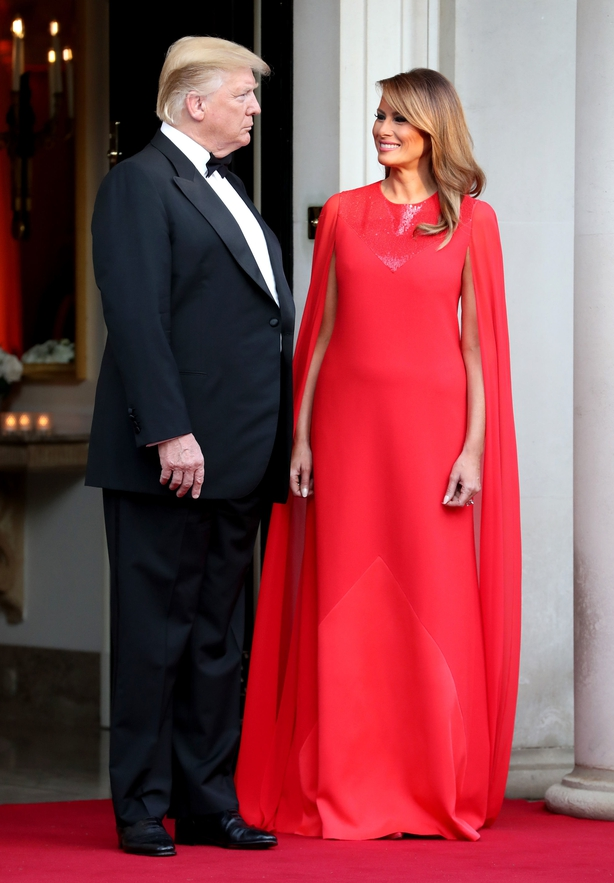 US President Donald Trump and his wife Melania wait to greet the Prince of Wales and the Duchess of Cornwall outside Winfield House, the residence of the Ambassador of the United States of America to the UK, in Regent's Park, London, for the Return Dinner as part of his state visit to the UK.
