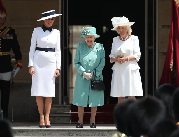 Melania Trump (left) and The Duchess of Cornwall (right) stand beside Queen Elizabeth II during the Ceremonial Welcome at Buckingham Palace, London, on day one of his three day state visit to the UK.