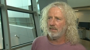 Mick Wallace is alleged to have threatened to burn down his house over loan refusal