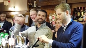 Donald Trump Jnr (L) and Eric Trump pulling pints in Doonbeg last night