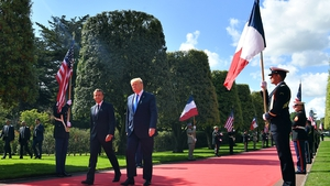 Emmanuel Macron and Donald Trump attending a D-Day commemoration