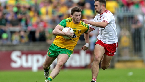 Donegal's Eoghan Ban Gallagher and Niall Sludden of Tyrone compete during last year's quarter-final clash