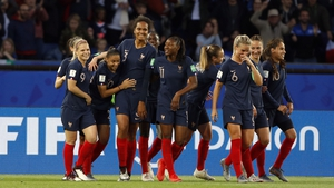 All ten outfield players celebrate Wendie Renard's goal as France won 4-0