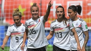 Giulia Gwinn (15) celebrates with her Germany team-mates after scoring the only goal of the game
