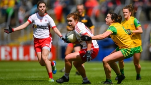 Niamh O'Neill of Tyrone evades Nicole McLaughlin of Donegal