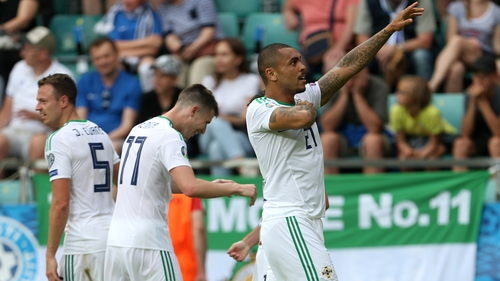 Northern Ireland's Josh Magennis celebrates in front of the large travelling support in Tallinn