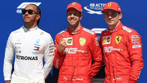 Sebastian Vettel gestures his number one place on the grid ahead of Sunday's grand prix