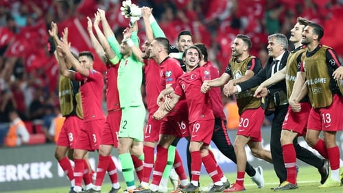 The Turkish players celebrate their win over world champions France