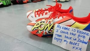 Ciaran McHugh originally hoped to gather 500 pairs of sport shoes, but generous locals donated more than 2,500 pairs