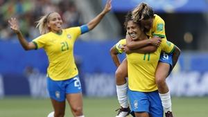 Cristiane (11) celebrates with team-mates