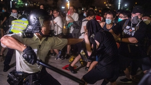 The violence began after police moved to clear protesters