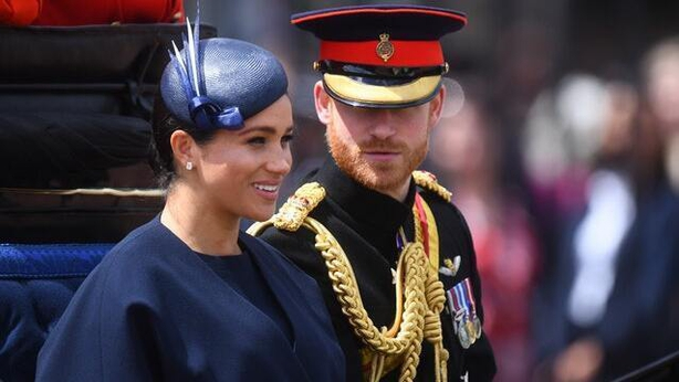 The Duke and Duchess of Sussex make their way along The Mall to Buckingham Palace, in London, after the Trooping the Colour ceremony, as Queen Elizabeth II celebrates her official birthday (PA)