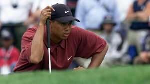 Tiger Woods lines up a putt on the first green during the final round of the 100th U.S. Open at Pebble Beach in 2000