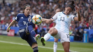 Virginia Gomez of Argentina competes for the ball with Yui Hasegawa of Japan