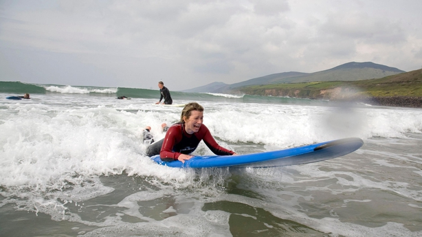Abi Jackson surfing (sort of!) at Inch Beach (Tadhg Hayes/PA)