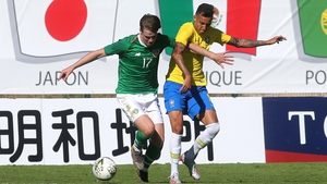 Ireland's Steven Mallon battles for possession with Iago of Brazil