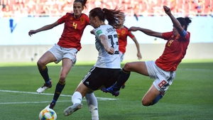 Spain's Marta Torrejon (R) and  Irene Paredes (L) try to block Germany's goalscorer Sara Dabritz