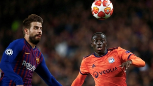 Ferland Mendy (R) in action against Barcelona for Lyon