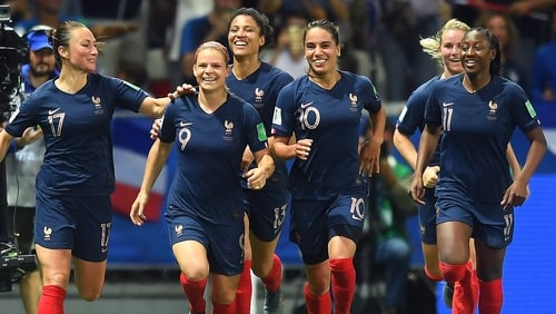 Eugenie Le Sommer of France celebrates with teammates