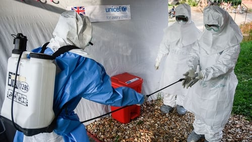 Medical staff of an Ebola Treatment Unit in western Uganda prepare for work