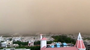 The city was experiencing a heatwave before the dust storm and rain brought temperatures down, according to local reports