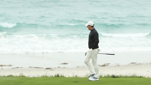 Rory McIlroy takes a wee dander down by the Pacific Ocean on the majestic Pebble Beach course