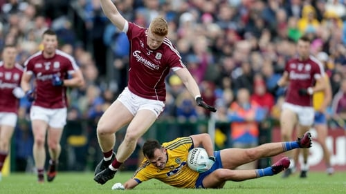Roscommon's Donal Smith tackled by Sean Andy O'Ceallaigh of Galway during last year's Connacht final