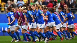 Italian players celebrate their progression to the last 16