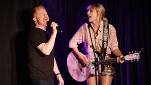 Jesse Tyler Ferguson (L) and Taylor Swift perform at AEG and Stonewall Inn's pride celebration commemorating the 50th anniversary of the Stonewall Uprising.