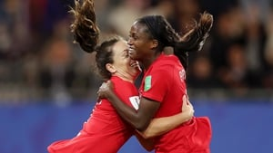 Nichelle Prince of Canada celebrates with teammate Allysha Chapman after scoring her team's second goal