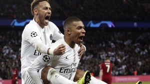 Neymar (L) and Kylian Mbappe after PSG scored agaisnt Liverpool in last season's Champions League