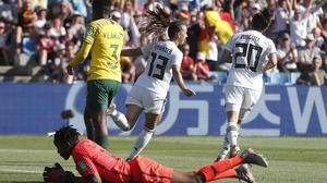 Sara Daebritz (C) of Germany celebrates scoring