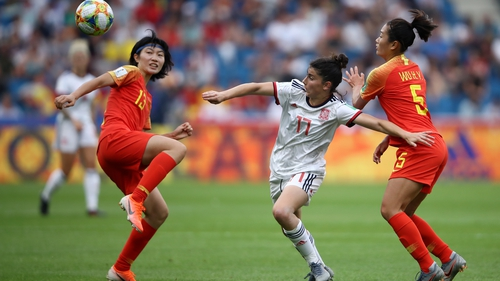 Yan Wang of China is challenged by Lucia Garcia of Spain