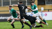 Ireland winger Jonathan Wren is tackled by England's Ted Hill in Rosario