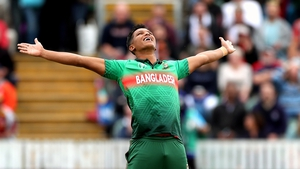 Mohammad Saifuddin celebrates taking the wicket of West Indies' Chris Gayle for a duck